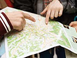 Fingers pointing at a city map